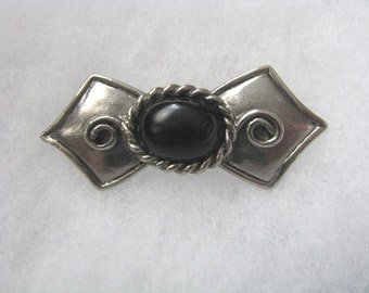 Modern silver and black stylized bow brooch pin