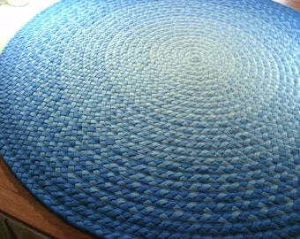 "48""-60""or 66"" in diameter shades of blue braided rug created from new cotton t shirts"
