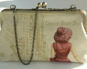 Bronze frame clutch/ purse/  walking lady in red dress and hat / New York