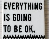 porcelain wall tag screenprinted text everything is going to be ok screenprinted text and hand drawn triangle pattern.