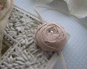 Caroline . elastic headband . toddler hair accessory . rolled fabric rose . beige
