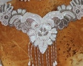 Cute embroidered  and beaded  applique  with  sequins white color 13 1/2 inches around the neck 6 inches center down with beading