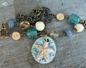 Winter at the Beach Ceramic Sea Star Pendant with Glass, Ceramic and Wood on Brass Chain