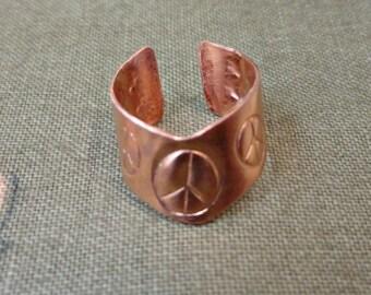 Copper Ear Cuff With Peace Symbols