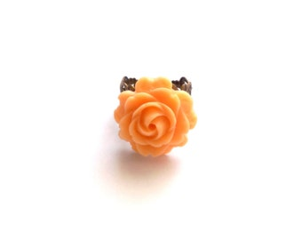 Salmon colored resin cabochon rose ring atop antique brass adjustable filigree, wedding, bridesmaid, christmas