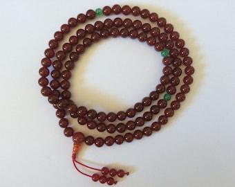 Tibetan Buddhist mala Carnelian mala 108 beads for meditation with green jade spacers