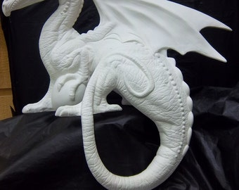 Grand Dragon Shelf Setter bisque you paint it your self.