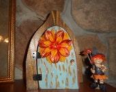 Sparkling Blue Flower Fairy Door with Bright Orange Flower