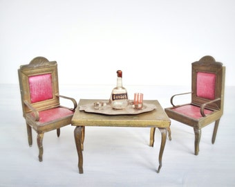 Antique doll house furniture, miniature metal dining table, arm chairs, gold painted tin, pink pressed cardboard, vintage early 20th century