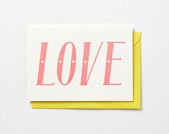 LOVE, in neon pink, letterpress folded note cards