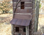 Primitive Lighted Tall Skinny Log Cabin w/ porch Folk Art  Brown w/ rusty metal accents ~ Comes w/ light and cord ~ Birdhouse ~  Very unique