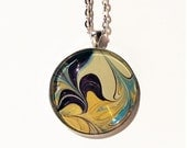 Turquoise, Mint, Purple and Orange Hand Painted Round Portable Art Necklace in a Shiny Silver Finish - Art to Wear around Your Neck!