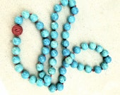 Strand Turquoise Blue 12 mm Beads Hand Strung w/ Carved Chinese Red Cinnabar Embellishment