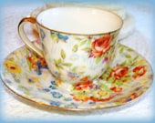 Antique Demitasse Cup Saucer. Full Floral Pattern. Made during Occupied Japan by Merit.  Gold Trim.
