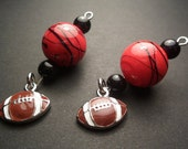Football charm dangle earrings with red swirl and black beads, University of Georgia dangle earrings, UGA dangle earrings, Bulldogs earrings