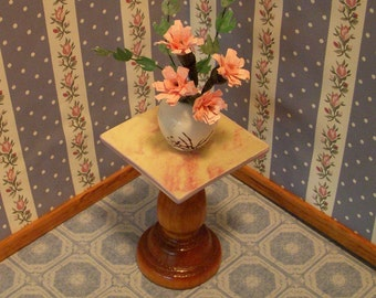 dollhouse scale pink flower arrangement in a white and green oriental vase
