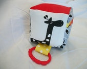 Baby block with red, yellow, black, white and a giraffe