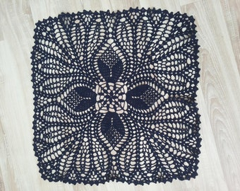Navy handmade crochet doily with floral design