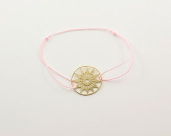 MANDALA brass handsawed bracelet with light pink nylon cord