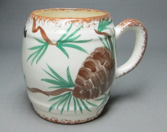 CLINCHFIELD pottery mug with pines cones . erwin tennessee