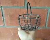 Vintage old metal wire industrial looking Basket with moving handle