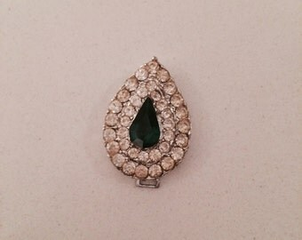 Emerald and rhinestone pendant