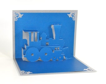 Pop Up 3D TRAIN LOCOMOTIVE Greeting CARD Home Décor Handmade Cut by Hand Origamic Architecture in Metallic Blue and Metallic Silver.
