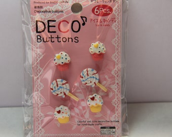 6 pieces of cupcakes and Swirl Lollipop candy buttons