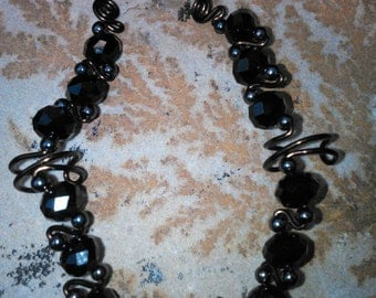 Jet black crystal ear cuffs pair.