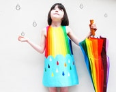Rainy Day baby girls rainbow spectrum print dress.