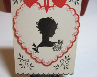 1930's art deco unused Gibson bridge tally card silhouette of lady on scalloped edged heart with red bow