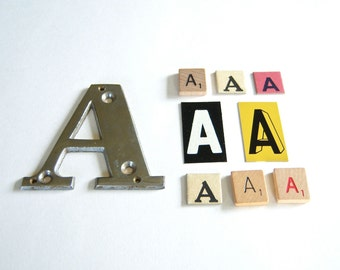 Letter A in Chrome, Paper, Metal, Wood - 9 piece assortment