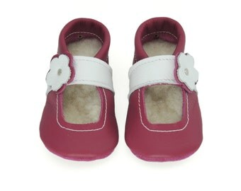 Handmade leather shoes for babies, toddlers and children.  Raspberry and white leather soft soled baby shoes.