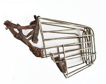 vintage metal and leather dog muzzle cage  from Elizabeth Rosen