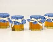1 mini 2 oz. hexagon mason jar with blue fabric filled with honey and topped with a white bow! Perfect for a winter and fall baby shower!