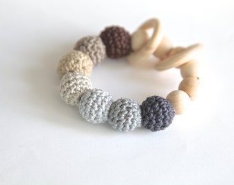 Brown and grey one natural nursing bracelet, rattle for baby. Teething ring toy with crochet wooden beads.