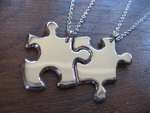 Two Silver Puzzle Piece Pendants