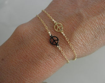 Tiny peace sign  bracelet with  goldfilled chain