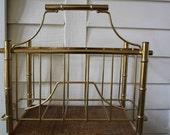 Faux bamboo magazine rack (Hollywood Regency)