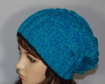 Hand knitted ladies slouchy beanie. A lovely hat available in teal.