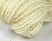 Pure creamy white Finn - worsted style. Hand spun yarn. Hand processed. 2 ply