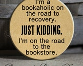 """I'm a bookaholic on the road to recovery. Just kidding. I'm on the road to the book store. on Tan Quote - 1.5"""" Pinback Button Sarcastic"""