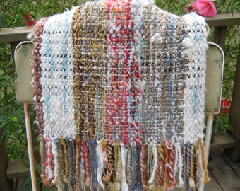 Hand woven shawl with hand spun art yarns and fringe