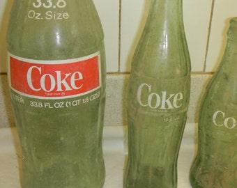 3 great old coke bottles