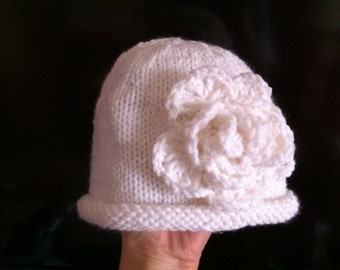 knitted hat with crochet flower and rolled brim