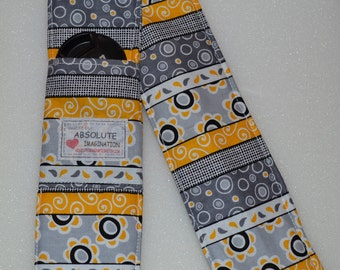 Gray and Yellow Stripe Fun Pattern.  Padded SLR or DSLR Camera Strap Cover. 2 Len Cap/SD Card. Pockets.