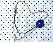 Chains and beaded necklace with crochet blue flower