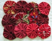 yo yos 30 2 inch assorted  shades of Red fabric yo yos