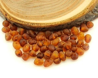 Natural Baltic Amber unpolished rounded beads - 50 pcs - S Cognac