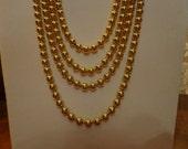 Vintage goldtone four strand bead necklace
